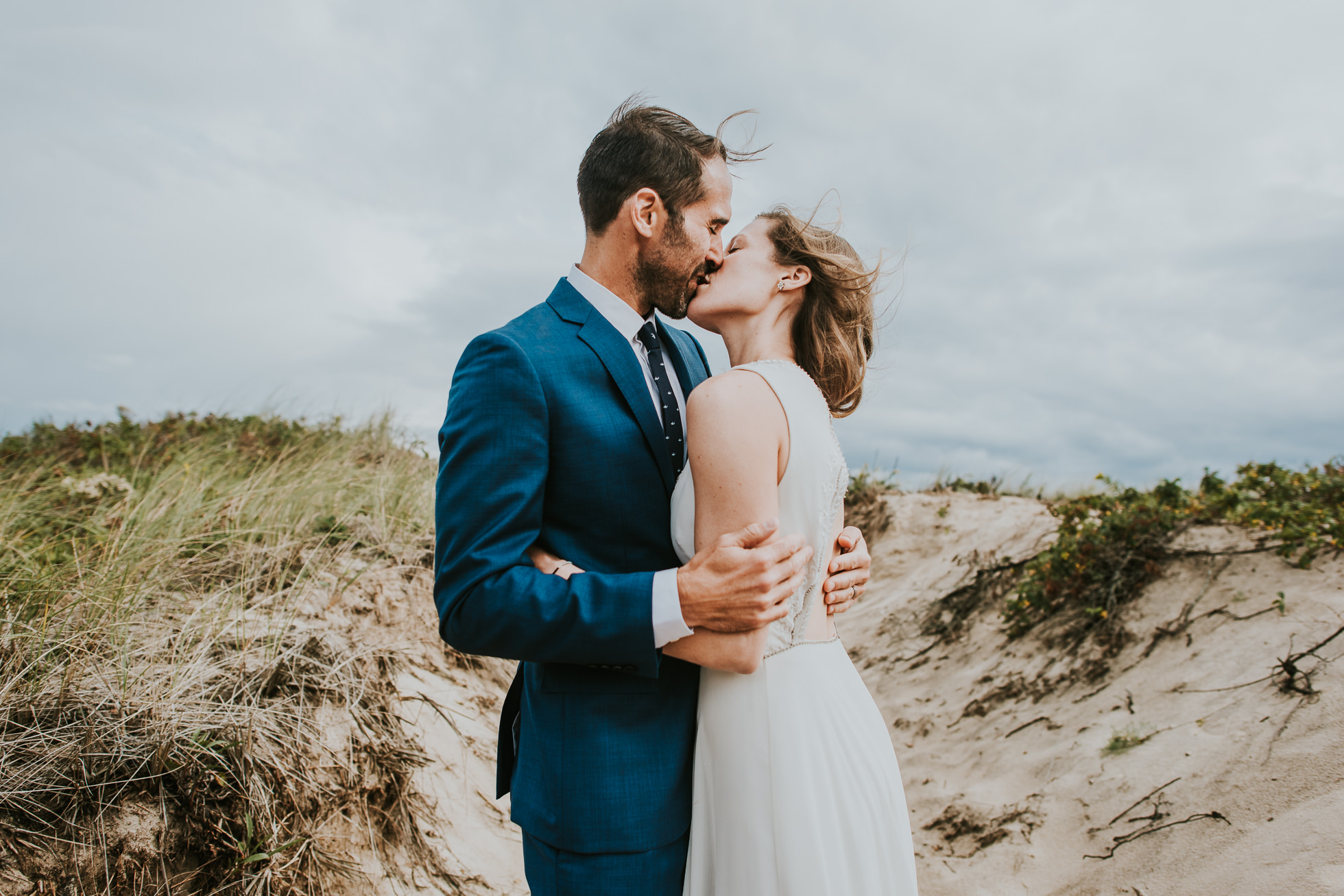 boho bride and groom at the beach Montauk wedding photographed by Traverse the Tides
