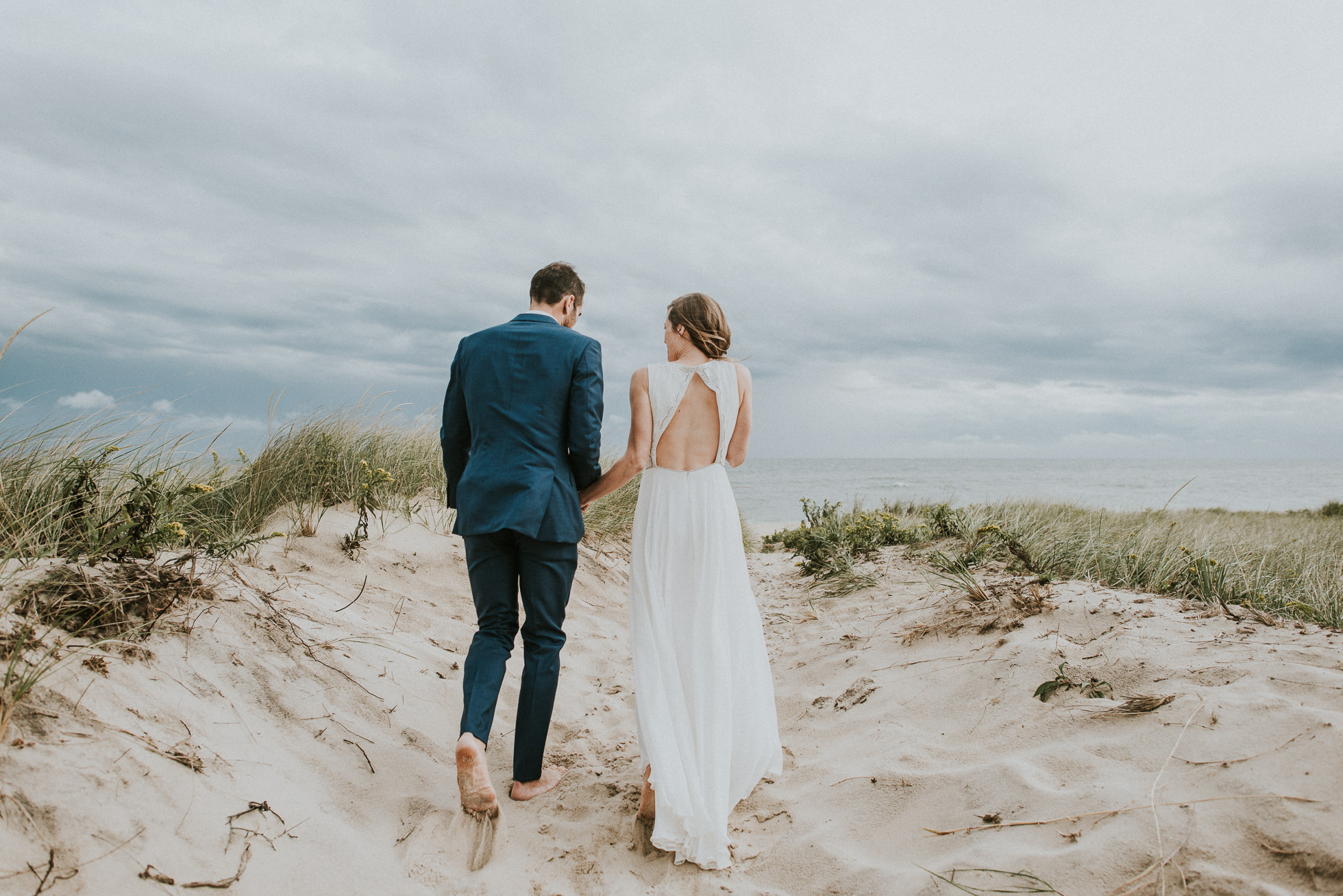 barefoot bride and groom at the beach Montauk wedding photographed by Traverse the Tides