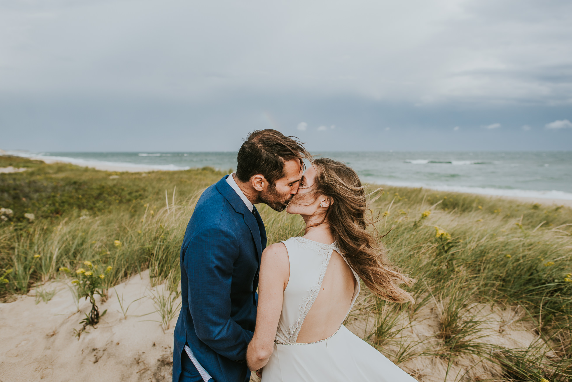 kissing bride and groom at the beach Montauk wedding photographed by Traverse the Tides