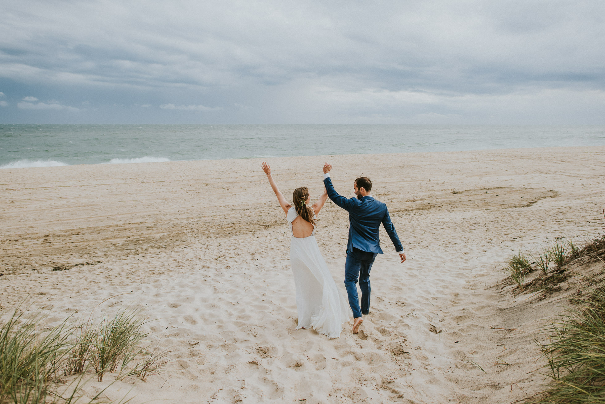 surfer bride and groom at the beach Montauk wedding photographed by Traverse the Tides