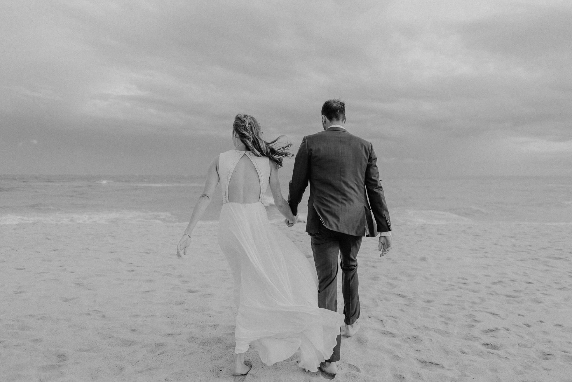 bride and groom at windy beach Montauk wedding photographed by Traverse the Tides