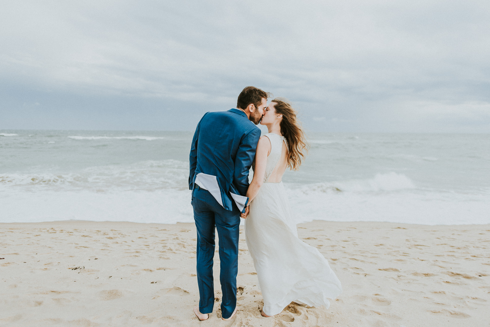bride and groom toes in the sand Montauk wedding photographed by Traverse the Tides