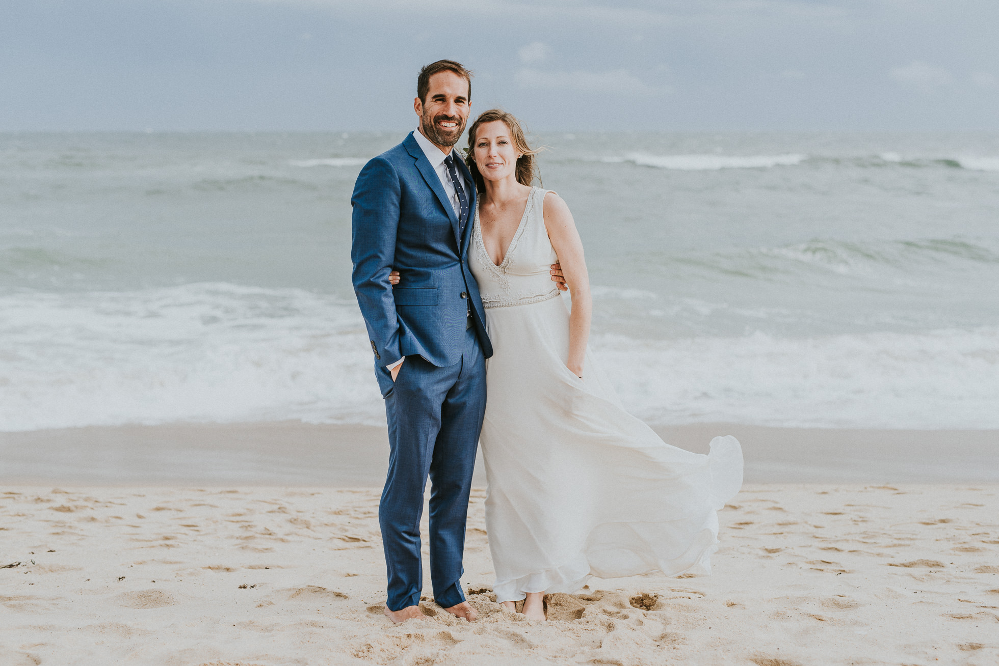 smiling bride and groom at beach Montauk wedding photographed by Traverse the Tides