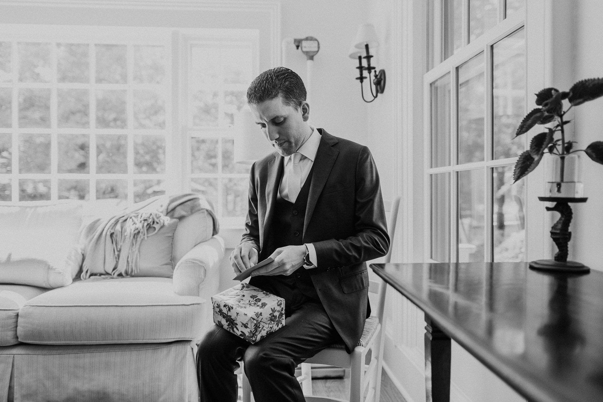 groom opening gift Hamptons wedding