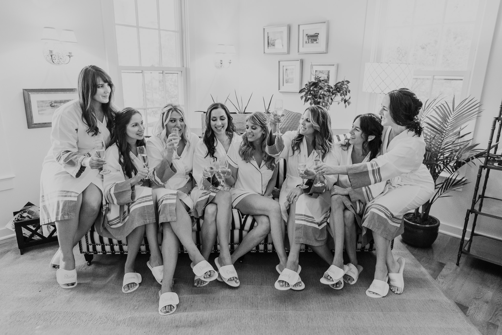 bride and girls drinking champagne the Hamptons