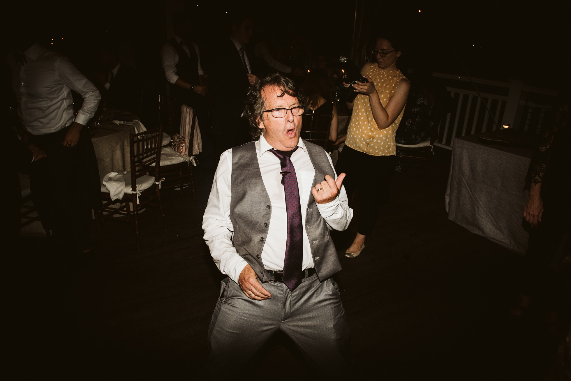 wedding guest playing air guitar