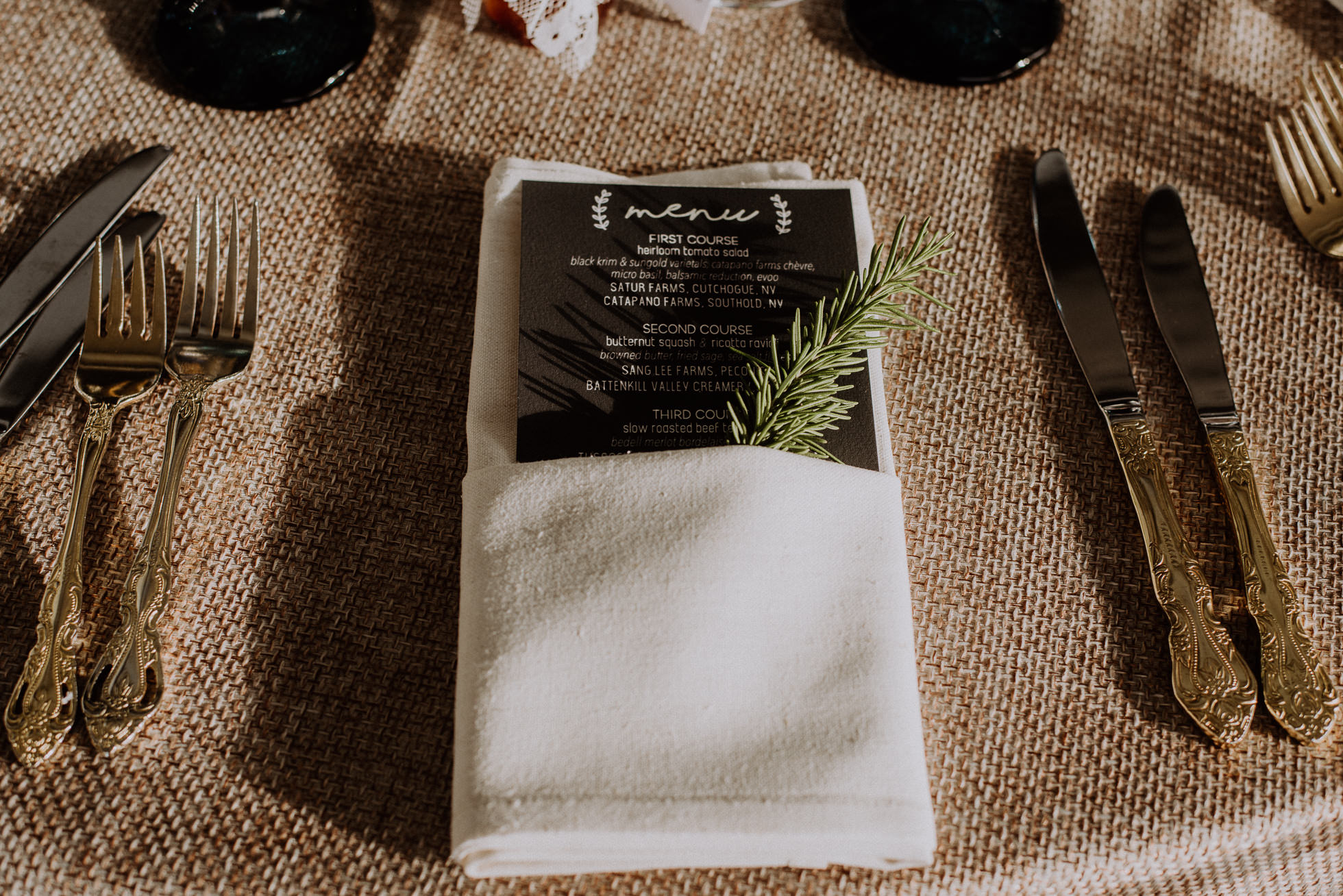 wedding table setting rosemary sprig